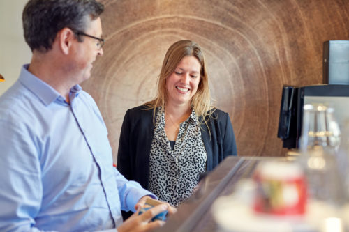 Festina Finance employees makes coffee and laughs